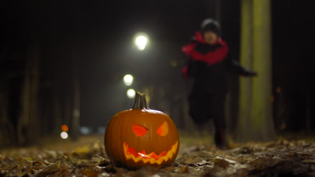 kid in halloween costumes run - jack o' lantern stock videos and b-roll footage