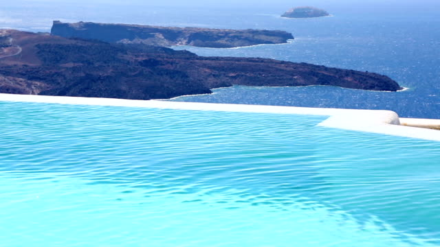 HD: Kid in infinity swimming pool on Santorini
