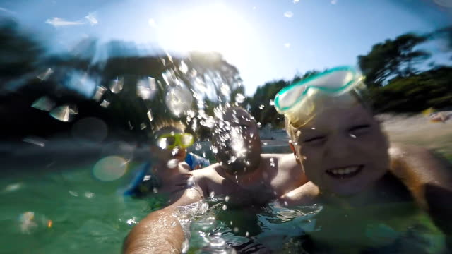 Kid is making faces underwater