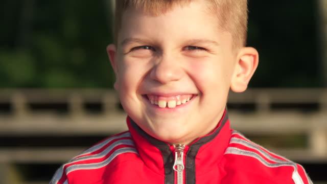 kid look at camera at sun - teeth stock videos and b-roll footage