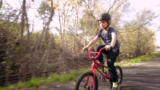 kid on red bike - bmx cycling stock videos and b-roll footage