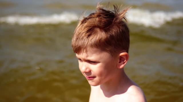Kid play on the beach