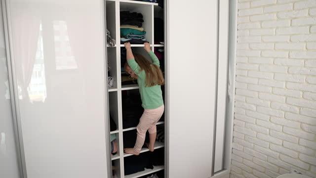 kid playing at home, exploring wardrobe - chaos stock videos & royalty-free footage