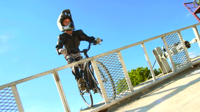 hd: bmx kid practicing sprint from the gate - bmx cycling stock videos and b-roll footage