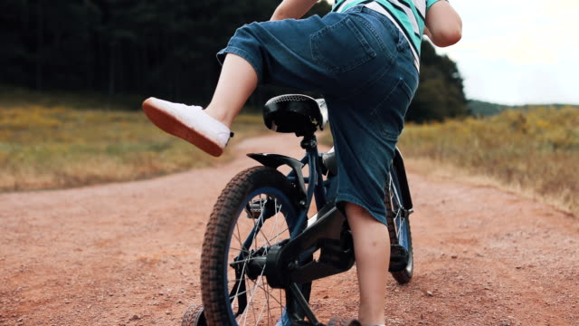 kid preparing his bike for ride - elbow pad stock videos & royalty-free footage