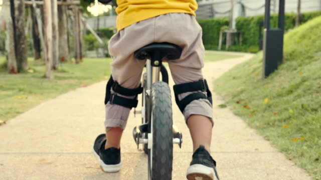 kid rides a bike - balance stock videos & royalty-free footage