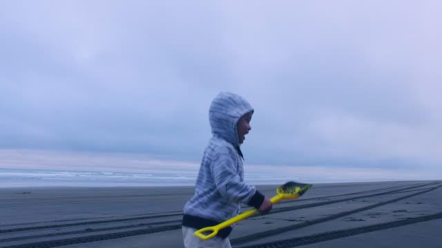 Kid Running At Beach.