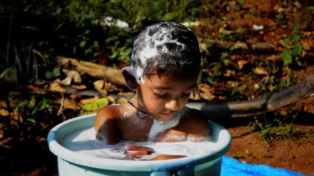kid taking bath in tub