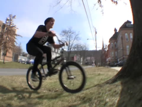 Kid tries a stunt on his bike where he shoots part way up a tree and then flips backwards But the tree didn't like that idea and knocks him on his...