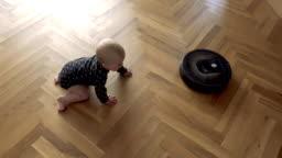Kid versus Robot Vacuum Cleaner