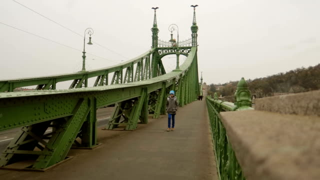 kid walks on a bridge - stock video - széchenyi chain bridge stock videos & royalty-free footage