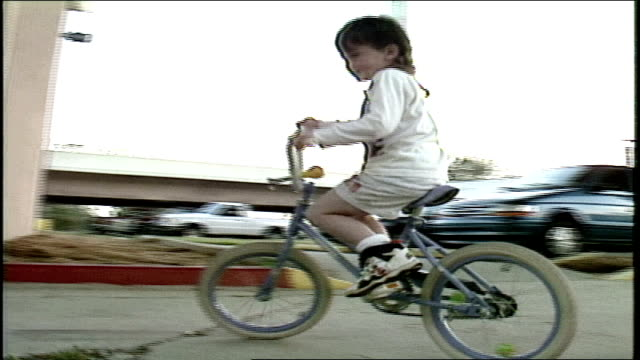 kid with mullet riding bike around camera in florida - hairstyle stock videos & royalty-free footage