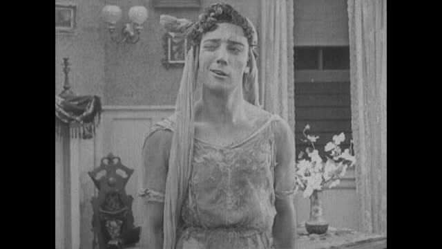 1917 a kidnapped bride's (buster keaton) true identity is revealed to the dismay of his rescuer (fatty arbuckle) - silent film stock videos & royalty-free footage