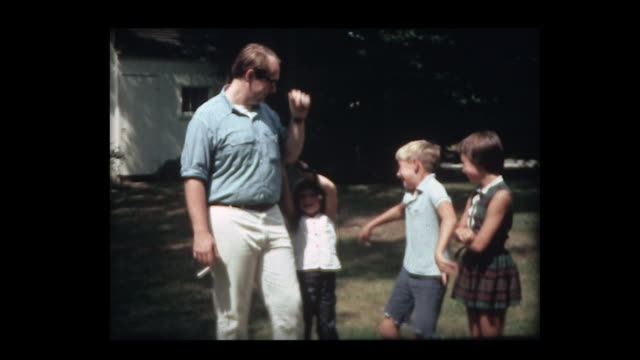 1966 kids act silly and uncle drives away in ford mustang - shelby stock videos & royalty-free footage