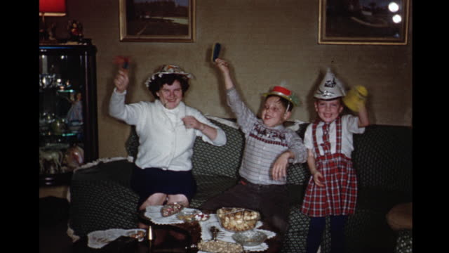 1960 ms kids (5-12) and  babysitter celebrating new year's eve, toronto, ontario, canada - 1960 stock videos & royalty-free footage