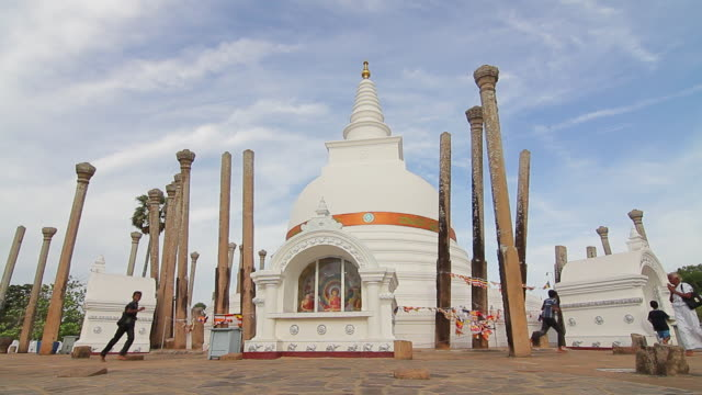 ms kids and worshippers circle thuparama dagoba, the first dagaba built in sri lanka after introduction of buddhism, contains collarbone of buddha / anuradhapura, north central province, sri lanka - religious equipment stock videos & royalty-free footage