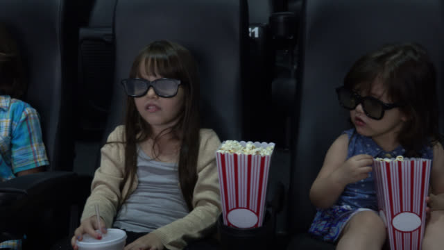 kids at the cinema watching a 3d movie - film industry stock videos & royalty-free footage