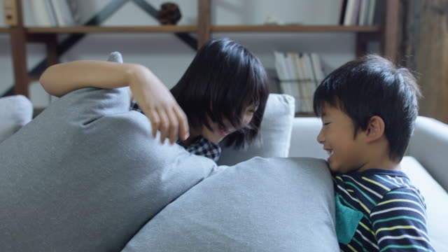 kids buried in sofa cushions - brother stock videos & royalty-free footage