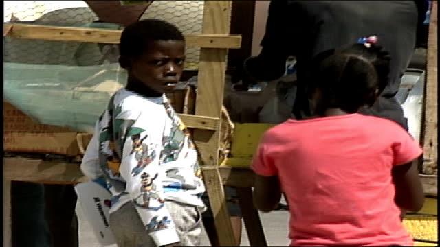 Kids Buying Ice Snack From Street Vendor in Jamaica