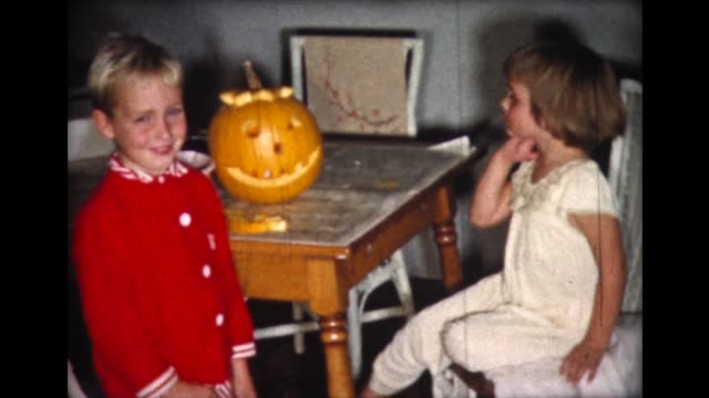 1961 kids carve pumpkin face - jack o' lantern stock videos and b-roll footage