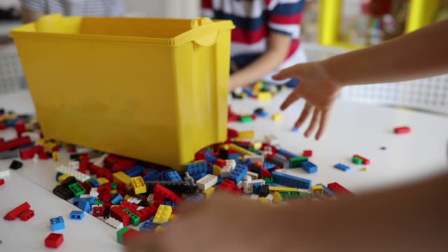 kids collecting toy blocks together - collection stock videos & royalty-free footage