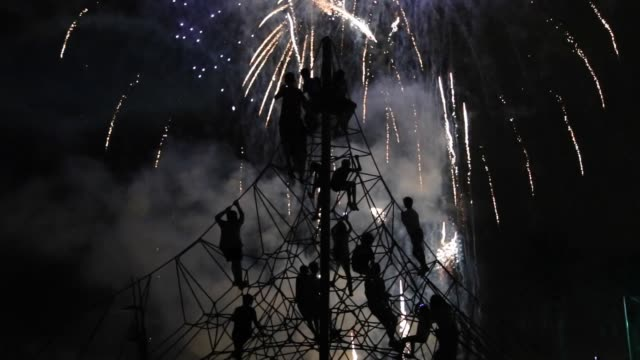 kids contemplating the fireworks at night on summer. - traditional festival stock videos & royalty-free footage