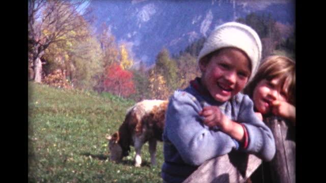 vidéos et rushes de 1963 kids, cows and swiss mountain - switzerland