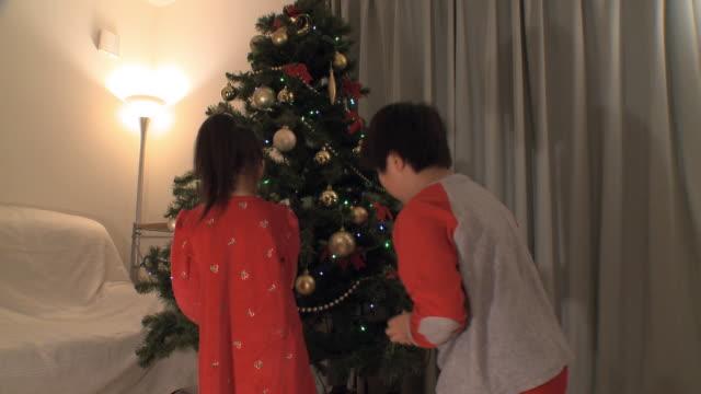 ms tu kids (2-9) decorating christmas tree / tokyo, japan   - christianity stock videos & royalty-free footage