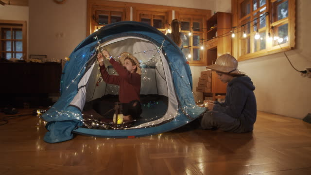 kids decorating the tent in the living room - living room stock videos & royalty-free footage