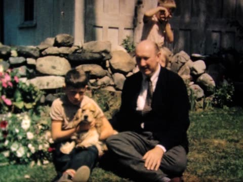 stockvideo's en b-roll-footage met 1938 kids, dog and dad - 1938