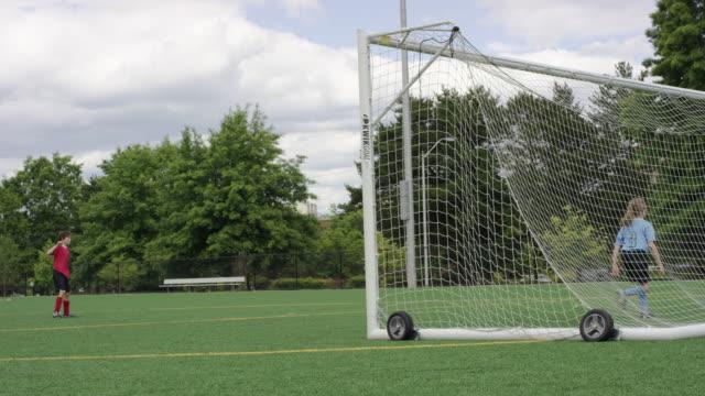 Kids doing a soccer penalty shootout