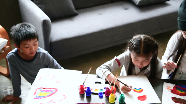kids drawing together in living room - living room stock videos & royalty-free footage