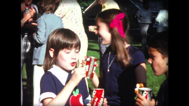 1975 kids drink from canada dry and hires root beer cans - 1975 stock videos and b-roll footage