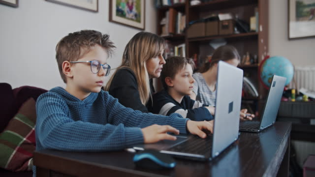kids during covid-19 quarantine attending to online school class. - educazione video stock e b–roll