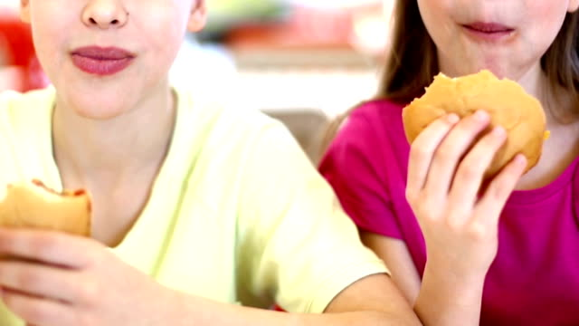kids eating burgers and fries. - obscured face stock videos & royalty-free footage