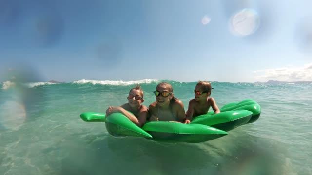 kids enjoying beach and sea vacations - beach holiday stock videos & royalty-free footage