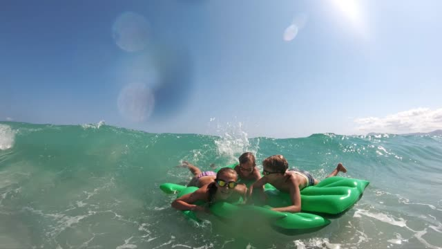 kids enjoying beach and sea vacations - inflatable stock videos & royalty-free footage