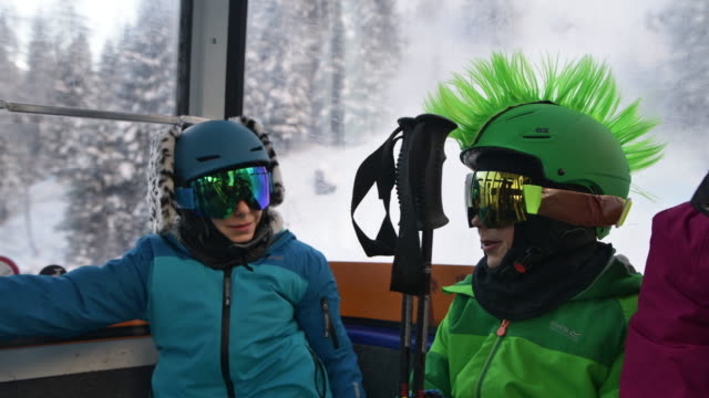 kids enjoying gondola ski lift ride. - cable car stock videos & royalty-free footage