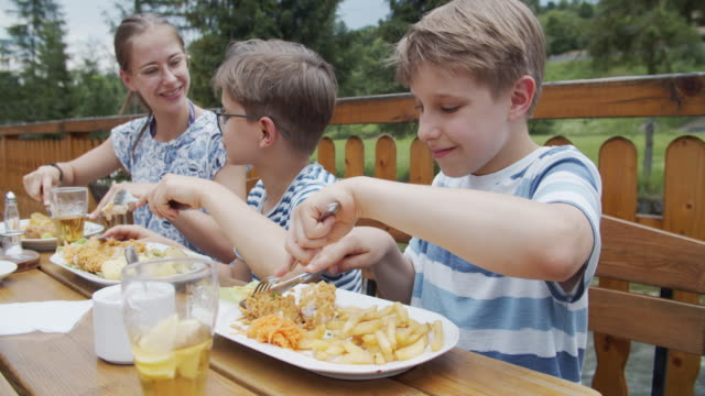 kids enjoying lunch outdoors - poland stock videos & royalty-free footage