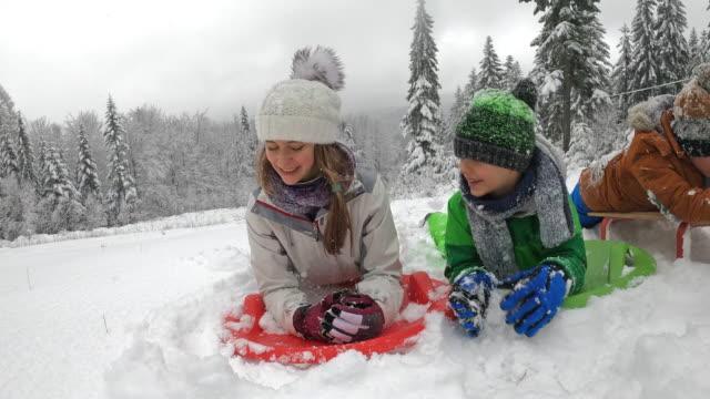 kids enjoying sledding in winter - imgorthand stock videos & royalty-free footage