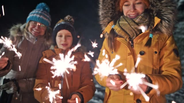 kids enjoying sparklers at new year's eve night - pre adolescent child stock videos & royalty-free footage