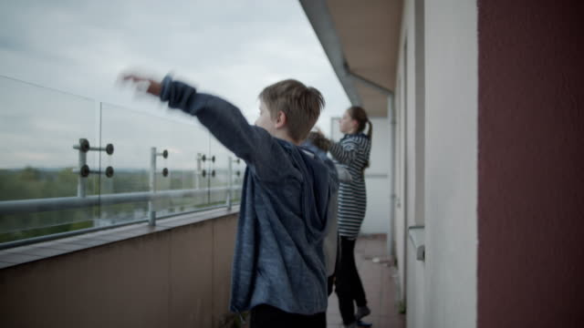 kids exercising at balcony the covid-19 pandemic - balcony stock videos & royalty-free footage