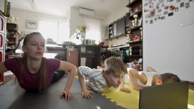 kids exercising at home during the covid-19 pandemic - bodyweight training stock videos & royalty-free footage