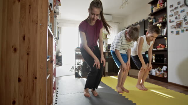 kids exercising at home during the covid-19 pandemic - warm up exercise stock videos & royalty-free footage