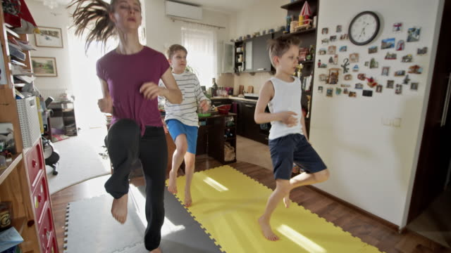 kids exercising at home during the covid-19 pandemic - dolly shot stock videos & royalty-free footage