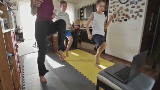kids exercising at home during the covid-19 pandemic - competition stock videos & royalty-free footage