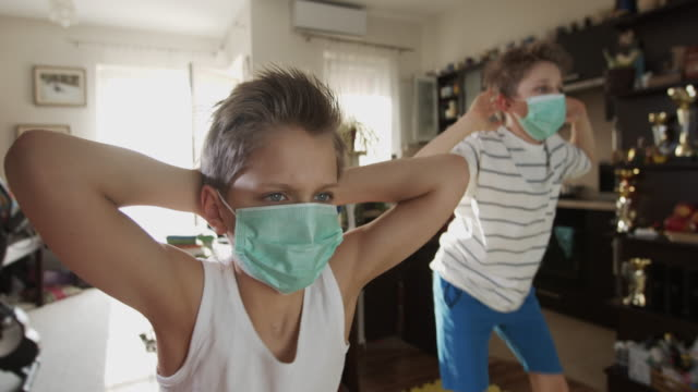 kids exercising at home during the covid-19 pandemic - instructions stock videos & royalty-free footage