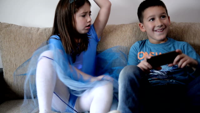 kids fighting over phone - sibling stock videos and b-roll footage