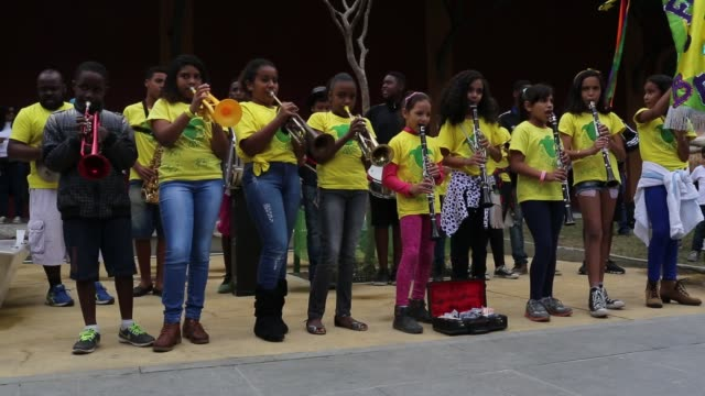 kids from the favela brass band play for visitors on olympic boulevard on august 12 2016 in rio de janeiro brazil - brass band stock videos & royalty-free footage