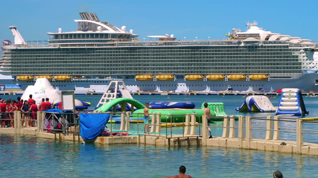 """kids from the """"harmony of the seas"""" royal caribbean cruise ship ready for swimming in the ocean on a tropical island beach during summer vacation in labadee, haiti, 4k - caribbean sea stock videos & royalty-free footage"""